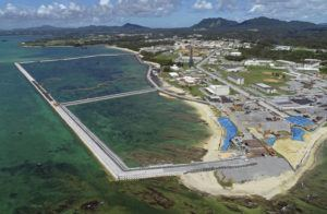 KOJI HARADA/KYODO NEWS VIA ASSOCIATED PRESS Preliminary construction work, seen in Aug. 2018, off Henoko, in Nago city, Okinawa prefecture, Japan, where the Japanese government plans to relocate a U.S. air base from one area of Okinawa's main island to another. Okinawa Gov. Denny Tamaki urged Japan's central government to stop the construction it unilaterally started to allow a U.S. Marine Corps. base to relocate to a less-crowded area of the southern Japanese island despite local opposition, responding to a new defense ministry estimate that it would take more than twice the time and cost than previously thought to get the base closed and returned to Okinawan sovereignty.