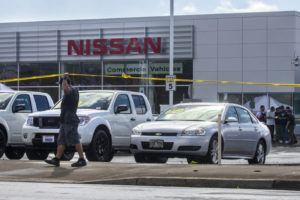 KAT WADE / SPECIAL TO THE STAR-ADVERTISER                                 Police investigate a shooting near New City Nissan in Kalihi today.