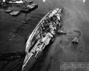 COURTESY U.S. NAVY                                 Workers right the USS Oklahoma in Pearl Harbor following the Dec. 7, 1941, attack.