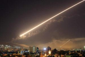 ASSOCIATED PRESS / 2018                                 Skies erupt with surface to air missile fire as the U.S. launches an attack on the Syrian capital of Damascus last year.