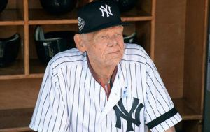 ASSOCIATED PRESS                                 The New York Yankees' Don Larsen sits in the dugout before the Yankees' Old-Timers' Day baseball game at Yankee Stadium in New York in 2018. Larsen, the journeyman pitcher who reached the heights of baseball glory in 1956 for the Yankees when he threw a perfect game and only no-hitter in World Series history, has died. He was 90.