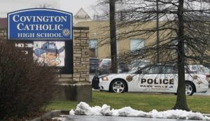 ASSOCIATED PRESS / JAN. 19, 2019                                 A police car sits at the entrance to Covington Catholic High School in Park Hills, Ky.