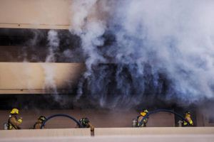 DENNIS ODA / DODA@STARADVERTISER.COM                                 Firemen put out a fire today at 1630 Liholiho St. in Makiki.