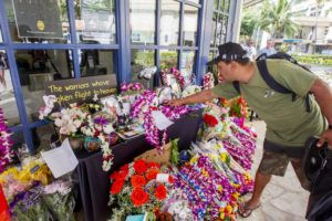 DENNIS ODA / DODA@STARADVERTISER.COM                                 A memorial of flowers and mementos have sprung up in front of the Waikiki Police Sub station to remember the police officers, Tiffany Enriquez and Kaulike Kalama, who were shot and killed while responding Hibiscus Drive on Diamond Head.