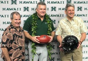 BRIAN McINNIS / bmcinnis@staradvertiser.com University of Hawaii athletic director David Matlin, Todd Graham, and UH President David Lassner pose for photographers after Graham was introduced today as the new UH head football coach in Manoa.