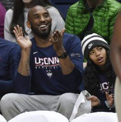 ASSOCIATED PRESS                                 Kobe Bryant and his daughter Gianna watch the first half of an NCAA women's game between Connecticut and Houston in Storrs, Conn., on March 2, 2019.