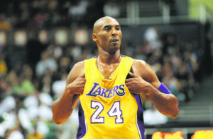 JAMM AQUINO / OCT. 4, 2015                                 Los Angeles Lakers guard Kobe Bryant adjusts his jersey during a pre-season at the Stan Sheriff Center. Bryant was among nine people who died in a helicopter crash on Sunday. Washington Post reporter Felicia Sonmez was suspended after tweeting about Bryant's 2003 rape allegation. Her tweet was posted hours after the crash.