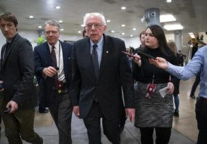 ASSOCIATED PRESS                                 Democratic presidential candidate, Sen. Bernie Sanders, I-Vt., talks to reporters just after the start of the impeachment trial of President Donald Trump on charges of abuse of power and obstruction of Congress, at the Capitol in Washington, on Thursday.