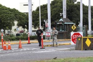 ASSOCIATED PRESS                                 Security stood outside the main gate at Joint Base Pearl Harbor-Hickam on Dec. 4. Security forces temporarily shut down all gates at Joint Base Pearl Harbor-Hickam overnight after they responded to a suspicious vehicle, according to base officials.