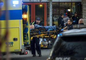 JAY JANNER/AUSTIN AMERICAN-STATESMAN VIA AP                                 Paramedics transport a stabbing victim in Austin, Texas.