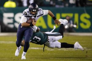 ASSOCIATED PRESS Seattle's Russell Wilson rushes past Philadelphia's Nigel Bradham during the second half.