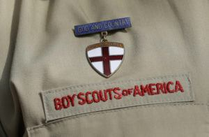 ASSOCIATED PRESS / FEB. 2013                                 A close-up of a Boy Scout uniform badge during a news conference in front of the Boy Scouts of America headquarters in Irving, Texas. A team of lawyers filed a lawsuit, today, in federal court in Washington, D.C., seeking to establish the nation's capital as a venue for men across the U.S. to sue the Boy Scouts of America for allegedly failing to protect them from long-ago sexual abuse at the hands of scoutmasters and other scout leaders.