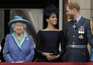 ASSOCIATED PRESS                                 Britain's Queen Elizabeth II, Meghan the Duchess of Sussex and Prince Harry watched a flyby of Royal Air Force aircraft, in July 2018, over Buckingham Palace in London. Queen Elizabeth II agreed today to grant Prince Harry and and his wife Meghan their wish for a more independent life, allowing them to move part-time to Canada while remaining firmly in the House of Windsor.