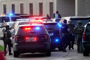 ASSOCIATED PRESS Police officers respond to a shooting at Bellaire High School today in Bellaire, Texas.