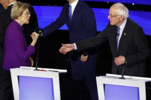 ASSOCIATED PRESS Democratic presidential candidate Sen. Elizabeth Warren, D-Mass., left and Sen. Bernie Sanders, I-Vt. talk today after a Democratic presidential primary debate hosted by CNN and the Des Moines Register in Des Moines, Iowa.