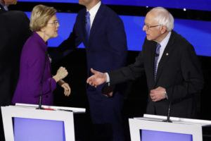 ASSOCIATED PRESS                                 Democratic presidential candidate Sen. Elizabeth Warren, D-Mass., left and Sen. Bernie Sanders, I-Vt. talk Tuesday, after the Democratic presidential primary debate hosted by CNN and the Des Moines Register in Des Moines, Iowa.