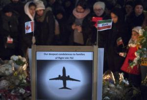 JONATHAN HAYWARD/THE CANADIAN PRESS VIA AP / JAN. 14 Mourners attend a memorial in North Vancouver, British Columbia, to remember Canadian victims in the deadly downing of a Ukrainian airliner the week before, in Iran.