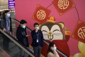 ASSOCIATED PRESS                                 People wore face masks as they ride an escalator at the Hong Kong International Airport in Hong Kong, today. Face masks sold out and temperature checks at airports and train stations became the new norm as China strove today to control the outbreak of a new coronavirus that has reached four other countries and territories and threatens to spread further during the Lunar New Year travel rush.