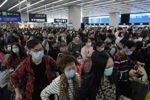 ASSOCIATED PRESS                                 Passengers wore protective face masks, Thursday, at the departure hall of the high-speed train station in Hong Kong. Chinese authorities Thursday moved to lock down three cities that are home to more than 18 million people in an unprecedented effort to contain the deadly new virus that has sickened hundreds and spread to other parts of the world during the busy Lunar New Year travel period.