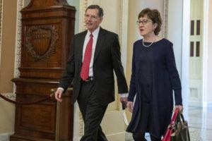ASSOCIATED PRESS                                 Sen. John Barrasso, R-Wyo., left, and Sen. Susan Collins, R-Maine, walk to the Senate chamber for the impeachment trial of President Donald Trump at the Capitol.