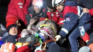 IHA VIA AP                                 Rescue workers carry a wounded person after they rescued him from the debris of a collapsed building following a strong earthquake in Elazig in the eastern Turkey. The earthquake rocked eastern Turkey on Friday, causing some buildings to collapse and killing scores of people, Turkish officials said.