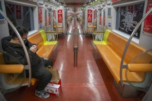 ASSOCIATED PRESS                                 A man wearing a face mask rides a nearly empty subway train in Beijing today. The new virus accelerated its spread in China, and the U.S. Consulate in the epicenter of the outbreak, the central city of Wuhan, announced it will evacuate its personnel and some private citizens aboard a charter flight.