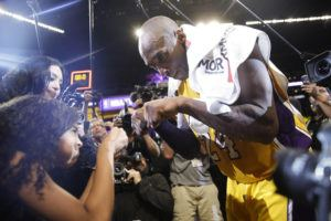 ASSOCIATED PRESS / 2016                                 Kobe Bryant, right, fist-bumps his daughter Gianna after the last NBA basketball game of his career, against the Utah Jazz in Los Angeles on April 13, 2016.