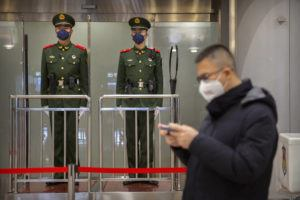 ASSOCIATED PRESS                                 Chinese paramilitary police wore face masks as they stood guard at Beijing Capital International Airport, Jan. 23, in Beijing. British Airways and Asian budget carriers Lion Air and Seoul Air are suspending all flights to China as fears spread about the outbreak of a new virus that has killed more than 130 people.