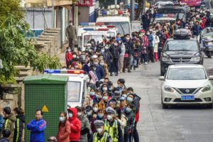 CHINATOPIX VIA ASSOCIATED PRESS                                 People lined up, Wednesday, to buy face masks from a medical supply company in Nanning in southern China's Guangxi Zhuang Autonomous Region.