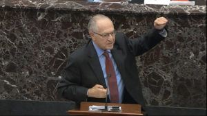 SENATE TELEVISION VIA ASSOCIATED PRESS                                 Alan Dershowitz, an attorney for President Donald Trump, answered a question during the impeachment trial against Trump in the Senate at the U.S. Capitol in Washington, Wednesday.