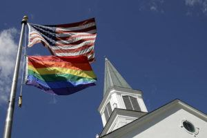ASSOCIATED PRESS                                 In this April 19, 2019, file photo, a gay pride rainbow flag flies along with the U.S. flag in front of the Asbury United Methodist Church in Prairie Village, Kan.