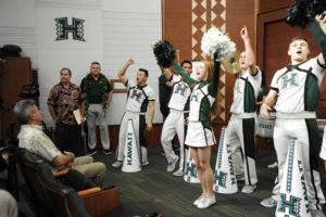 BRUCE ASATO / BASATO@STARADVERTISER.COM                                 University of Hawaii cheerleaders celebrate in the lecture hall prior to Todd Graham's introduction to the news media last week. Graham has filled the third phase of his football coaching staff with the addition of Dan Phillips as special teams coordinator.
