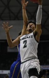 CINDY ELLEN RUSSELL / CRUSSELL@STARADVERTISER.COM                                 Hawaii's Justin Webster goes to make a basket during the second half.