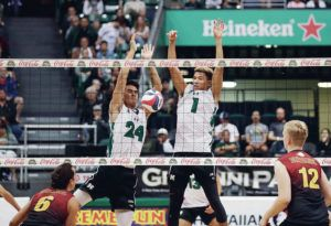 CINDY ELLEN RUSSELL / CRUSSELL@STARADVERTISER.COM                                 Hawaii's Danny Wong (24) and Chaz Galloway (1) tracked their block during a game earlier this month in Honolulu. Galloway today was named Freshman of the Week in men's volleyball by the Big West Conference.