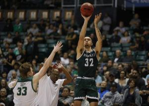 JAMM AQUINO / JAQUINO@STARADVERTISER.COM                                 Hawaii guard Samuta Avea (32) shoots a three point basket over Cal Poly forward Kyle Colvin (33) as head coach John Smith puts his hands over his head during a game today. Hawaii won 80-57.