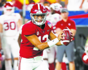 ASSOCIATED PRESS                                 Alabama quarterback Tua Tagovailoa (13) looks to pass during the first half of the Orange Bowl NCAA college football game against Oklahoma in 2018.