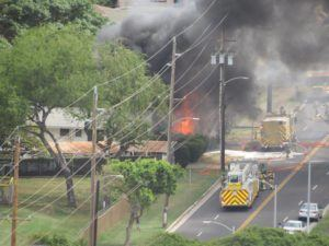 COURTESY ANYA PEREZ Firefighters battle a blaze that engulfed an unoccupied home today near Ala Wai Golf Course.