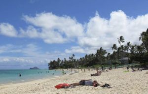 ASSOCIATED PRESS / 2013                                 People took in the sun and sand at the beach in Lanikai, a popular neighborhood for vacation rentals on Oahu. Oahu was the only major island to experience a drop in vacation rental supply and unit demand in January, according to a vacation rental report released today by the Hawaii Tourism Authority.