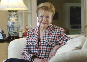 "ASSOCIATED PRESS / 2004                                 Author Mary Higgins Clark poses in her home in Saddle River, N.J. Clark, the tireless and long-reigning ""Queen of Suspense"" whose tales of women beating the odds made her one of the world's most popular writers, died Friday, Jan. 31, 2020, at age 92. Clark's publisher, Simon & Schuster, announced that Clark died in Naples, Fla, of natural causes."