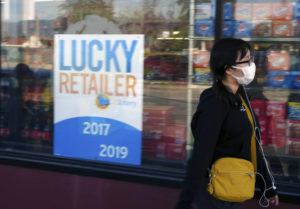 A pedestrian wears a protective mask in Alhambra, Calif., on Friday. As China grapples with the growing coronavirus outbreak, Chinese people in the Los Angeles area, home to the third-largest Chinese immigrant population in the United States, are encountering a cultural disconnect as they brace for a possible spread of the virus in their adopted homeland.