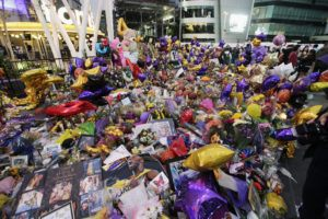 ASSOCIATED PRESS                                 Fans gather at a memorial for the late Kobe Bryant in front of Staples Center in Los Angeles on Sunday.