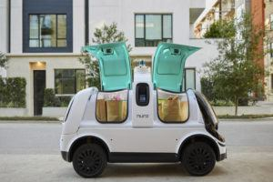 "NURO VIA ASSOCIATED PRESS Nuro's self-driving vehicle ""R2"" carried bags of groceries in an undated photo. The U.S. National Highway Traffic Safety Administration , today, granted temporary approval for Silicon Valley robotics company Nuro to the a low-speed autonomous delivery vehicle, without side and rear-view mirrors and other safety provisions required of vehicles driven by humans."