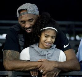 ASSOCIATED PRESS Former Los Angeles Laker Kobe Bryant and his daughter Gianna watched during the U.S. national championships swimming meet, in July 2018, in Irvine, Calif. Federal investigators said wreckage from the helicopter that crashed last month and killed Bryant, his daughter and seven others did not show any outward evidence of engine failure, the National Transportation Safety Board said today.