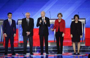 ASSOCIATED PRESS From left, Democratic presidential candidates former South Bend Mayor Pete Buttigieg, Sen. Bernie Sanders, I-Vt., former Vice President Joe Biden, Sen. Elizabeth Warren, D-Mass., and Sen. Amy Klobuchar, D-Minn., stand on stage.