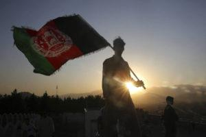 ASSOCIATED PRESS / AUG. 19                                 A man waves an Afghan flag during Independence Day celebrations in Kabul, Afghanistan.