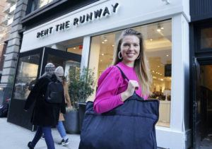 """ASSOCIATED PRESS                                 Vara Pikor posed for a picture, in Nov. 2019, in front of a """"Rent The Runway"""" store before returning some items in New York. Pikor wore some of the items she rented from the company, including her dress and earrings."""
