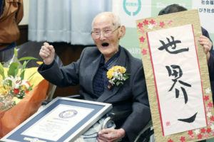 KYODO NEWS VIA ASSOCIATED PRESS                                 Chitetsu Watanabe, 112, posed next to the calligraphy he wrote after being awarded as the world's oldest living male by Guinness World Records, in Joetsu, Niigata prefecture, northern Japan Wednesday.