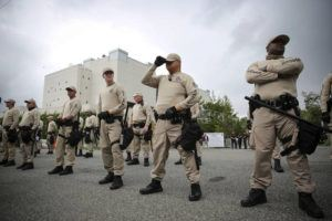 WILL VRAGOVIC/TAMPA BAY TIMES VIA ASSOCIATED PRESS                                 Troopers with the Florida Highway Patrol Quick Response Force lined up in front of the Phillips Center on the University of Florida campus in Gainesville, Fla., in Oct. 2017, ahead of white nationalist Richard Spencer's speech. White supremacist propaganda circulated on college campuses nearly doubled in 2019, according to a report by the Anti-Defamation League published today.