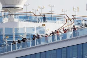 YUTA OMORI/KYODO NEWS VIA ASSOCIATED PRESS                                 Passengers stood Wednesday on the deck of the Diamond Princess cruise ship anchored at Yokohama Port in Yokohama, near Tokyo. Japan announced Thursday its first death from a new virus from China, hours after confirming 44 more cases on the cruise ship, quarantined near Tokyo as fears of the spreading disease mount in the country.