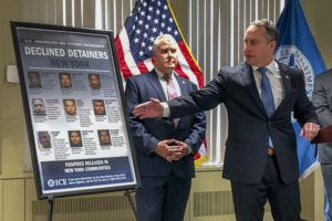 ASSOCIATED PRESS                                 Matthew Albence, right, the acting director of U.S. Immigration and Customs Enforcement, speaks during a news conference today in New York.